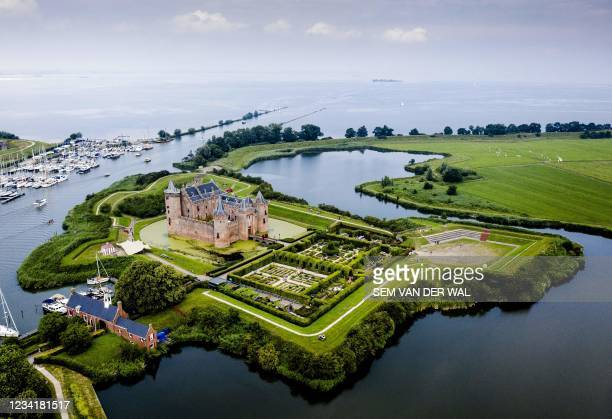 This aerial picture taken on July 25 in Muiden, near Amsterdam, shows the Muiderslot castle, part of the New Dutch Waterline. - The national...