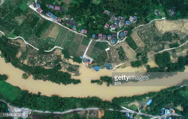 TOPSHOT This aerial picture taken on July 9 2019 shows flooding caused by heavy rain in Rongan in China's southern Guangxi region / China OUT