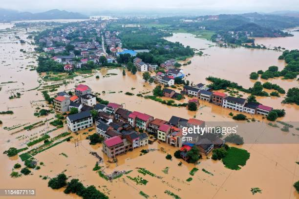 This aerial picture taken on July 9, 2019 shows submerged buildings after heavy rain caused flooding in Hengyang in central China's Hunan province. /...