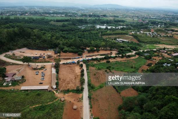 """This aerial picture taken on June 15, 2019 shows the road leading to the Tham Luang cave, in which 12 boys from the """"Wild Boars"""" football team and..."""