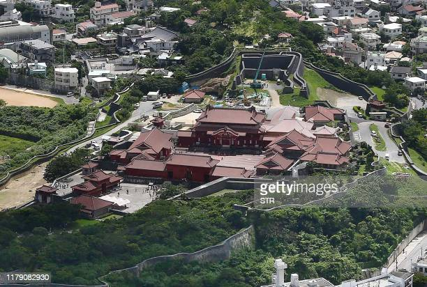 This aerial picture taken on June 27 2014 shows the historic Shuri Castle in Naha Okinawa prefecture southern Japan A fire ripped through the ancient...