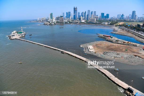 This aerial picture taken on March 22 shows a deserted road leading to the Haji Ali Dargah during a oneday nationwide Janata curfew imposed as a...