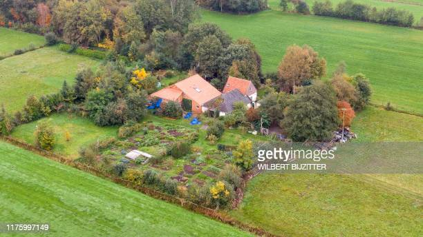 This aerial picture taken on October 15 2019 shows a farmhouse in a remote area of northern Netherlands' province of Drenthe near the village of...