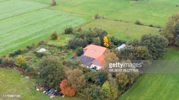 This aerial picture taken on October 15, 2019 shows a farmhouse in a remote area of northern Netherlands' province of Drenthe, near the village of...