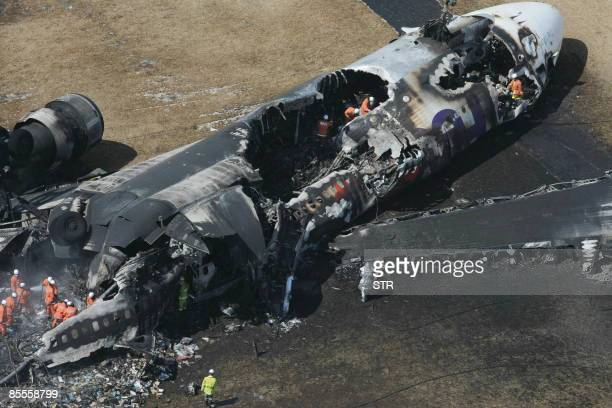 This aerial shot shows a bunt out FedEx cargo plane after it crashlanded on the runway of the Narita International Airport in Narita city in Chiba...