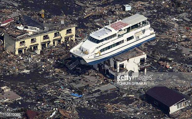This aerial shot shows a pleasure boat sitting on top of a building amid a sea of debris in Otsuchi town in Iwate prefecture on March 14 2011...