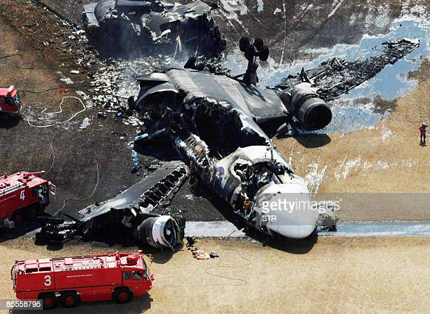 This aerial shot shows the bunt out FedEx cargo plane after it crashlanded on the runway of the Narita International Airport in Narita city in Chiba...