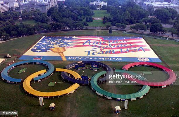 This aerial view of 12 July 1992 shows tents shaped as Olympic rings and the world's largest postcard displayed on the US capital's Elipse to promote...