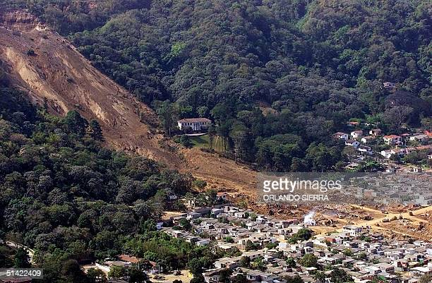 This aerial view shows 18 January the landslide caused by the 13 January earthquake that buried some 300 homes in Santa Tecla El Salvador The death...