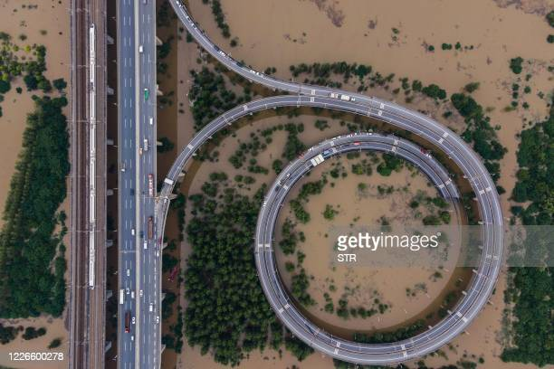 This aerial view shows a bridge leading to the inundated Tianxingzhou island, which is set to be a flood flowing zone to relieve pressure from the...