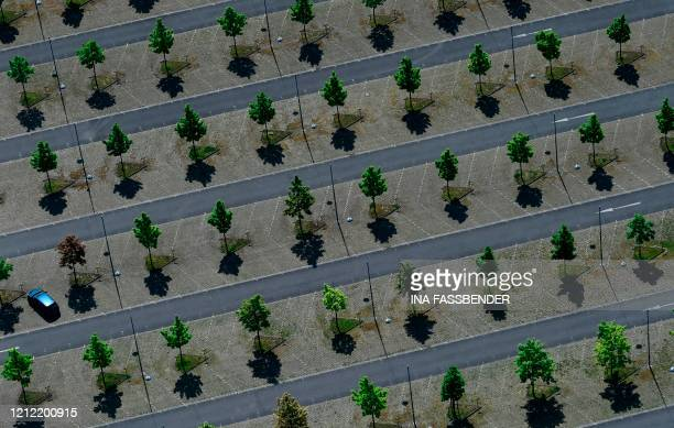 This aerial view shows a car at the parking area of the Signal Iduna Park of the Bundesliga club Borussia Dortmund in Dortmund western Germany on May...