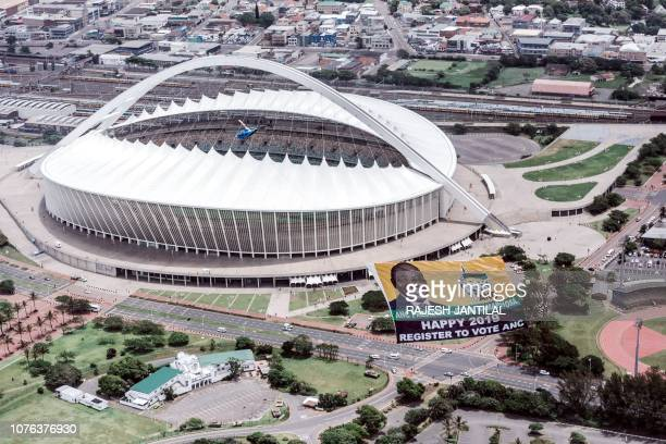 This aerial view shows a helicopter flying a giant flag from the South African ruling Party African National Congress urging people to register to...