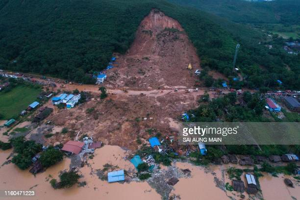 TOPSHOT This aerial view shows a landslide in Thalphyugone village in Paung township Mon state on August 9 2019 A landslide caused by heavy monsoon...