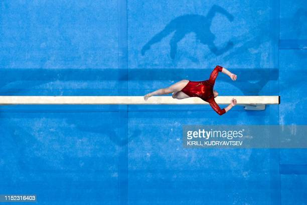 TOPSHOT This aerial view shows Belarus' Ganna Metelitsa competing in the balance beam event of the women's allaround qualification of the Artistic...