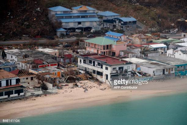 This aerial view shows buildings destroyed by Hurricane Irma on the French Caribbean island of Saint Martin on September 12 during the visit of...
