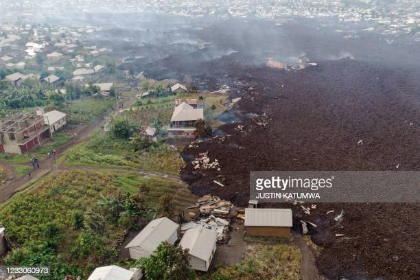 This aerial view shows debris engulfing buildings in Bushara village, Nyiragongo area, near Goma, on May 23 after a volcanic eruption of Mount...