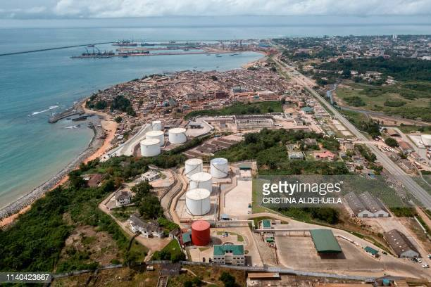 This aerial view shows fuel depots along Ghana's western coast in Takoradi on April 3, 2019. - Nearly eight percent of men in Ghana work in the...