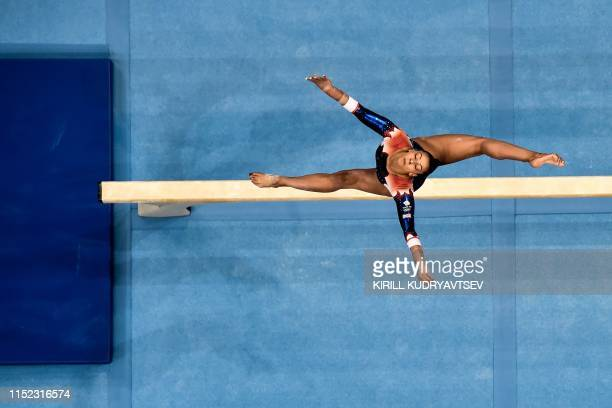 This aerial view shows Great Britain's Georgia-Mae Fenton competing in the balance beam event of the women's all-around qualification of the Artistic...