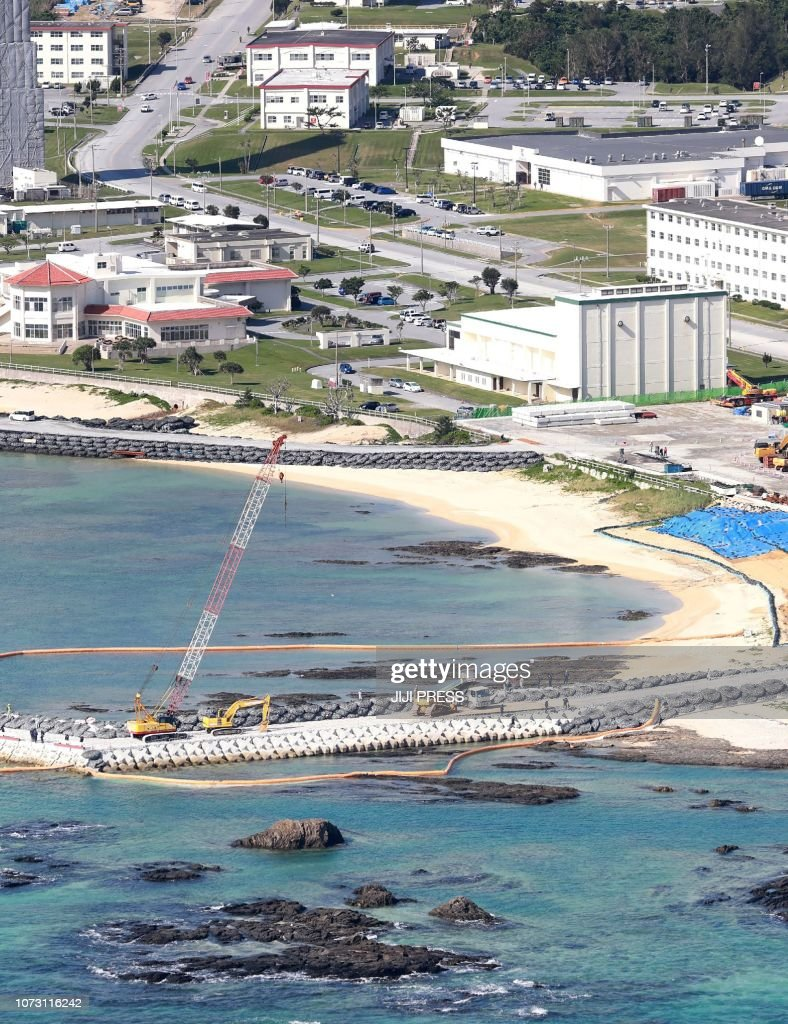 This aerial view shows land reclamation work on the Henoko coastal