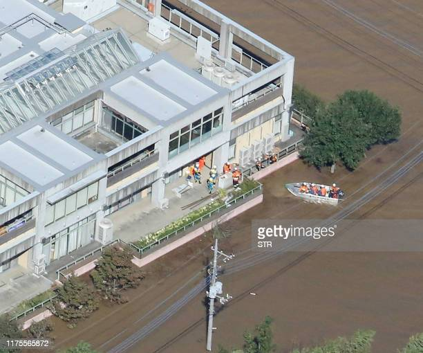 This aerial view shows rescue workers moving residents from the flooded Kawagoe Kings Garden nursing home besides the Oppegawa river in Kawagoe...