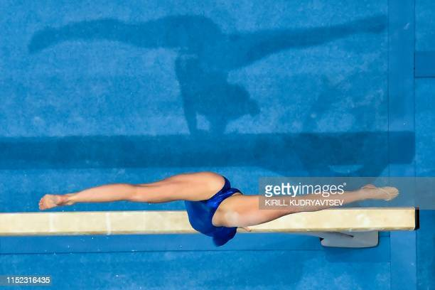 This aerial view shows Sweden's Jessica Castles competing in the balance beam event of the women's all-around qualification of the Artistic...