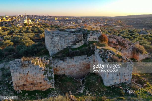 This aerial view shows the ancient Abu Sufyan castle, also locally known as al-Burj, in the Al-Bara area of Syria's Idlib province, on December 27,...