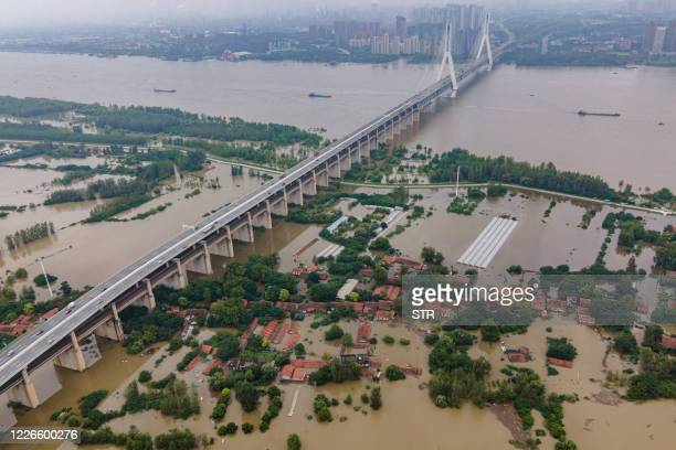 This aerial view shows the inundated Tianxingzhou island, which is set to be a flood flowing zone to relieve pressure from the high level of water in...