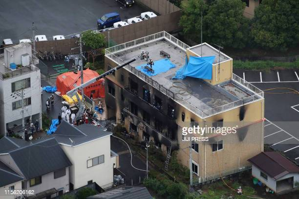 TOPSHOT This aerial view shows the rescue and recover scene after a fire at an animation company building killed some two dozen people in Kyoto on...