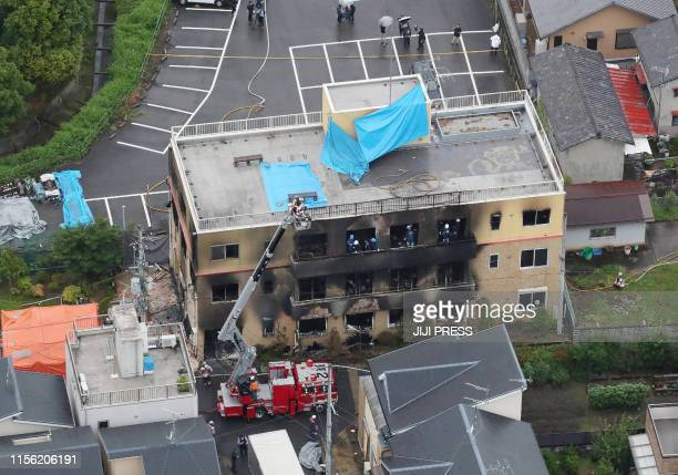 This aerial view shows the rescue and recover scene after a fire at an animation company building killed some two dozen people in Kyoto on July 18...