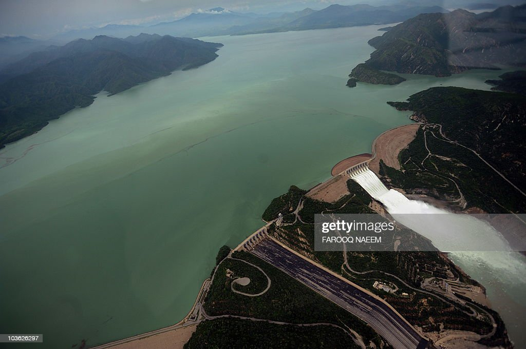 This aerial view shows water leaving the Tarbela Dam spillway in Tarbela on August 24, 2010. The United States and other countries worldwide have now pledged a total of more than 700 million dollars towards flood relief in Pakistan, a senior US official said. AFP PHOTO/Farooq NAEEM