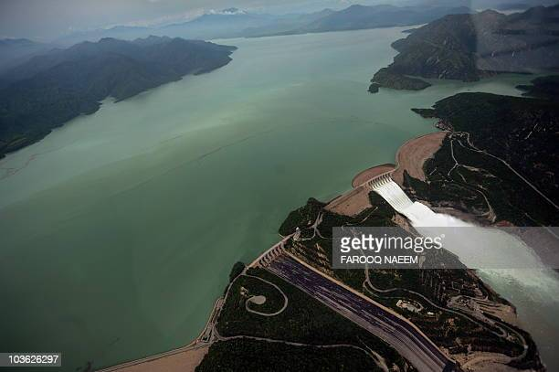 This aerial view shows water leaving the Tarbela Dam spillway in Tarbela on August 24 2010 The United States and other countries worldwide have now...