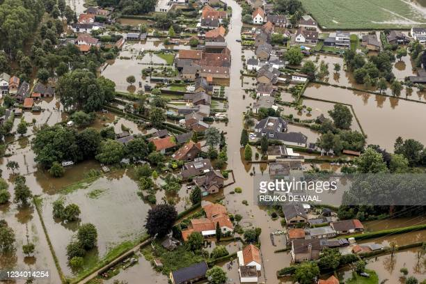 This aerial view taken in Brommelen on July 16, 2021 shows the flooded area around the Meuse after a levee of the Juliana Canal broke. - The death...