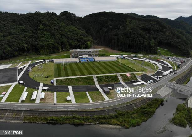 This aerial view taken on August 18 2018 shows the Otsuchi Bay of the Pacific Ocean and the newly built Kamaishi Recovery Memorial stadium also known...