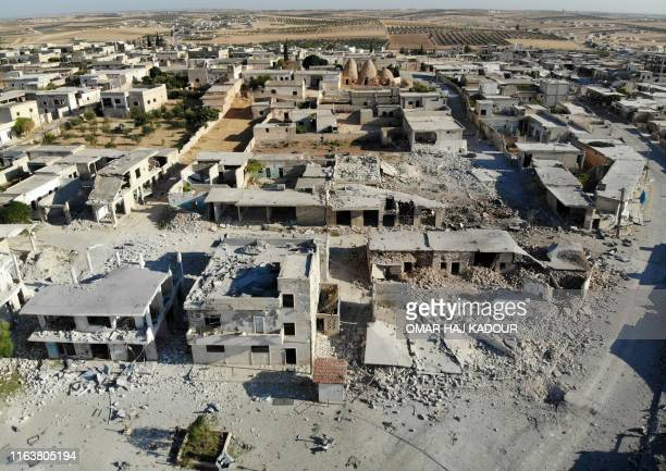This aerial view taken on August 25, 2019 shows a view of destruction and damaged buildings from Syrian government forces' bombardment in the village...
