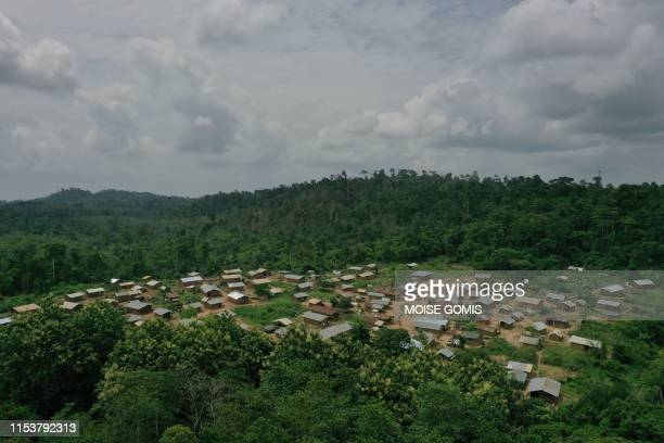 This aerial view taken on June 13, 2019 shows Ose Eke village surrounded by the Omo Forest, a home for elephants, northeast of Africa's biggest city...