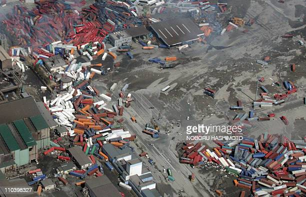 This aerial view taken on March 14 2011 during an AFPchartered flight shows containers piled up in the port of Sendai in Miyagi prefecture three days...