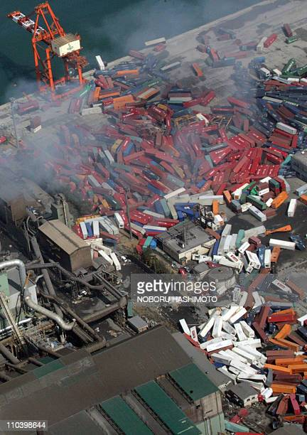 This aerial view taken on March 14 2011 during an AFPchartered flight shows overturned containers scattered around the port of Sendai in Miyagi...