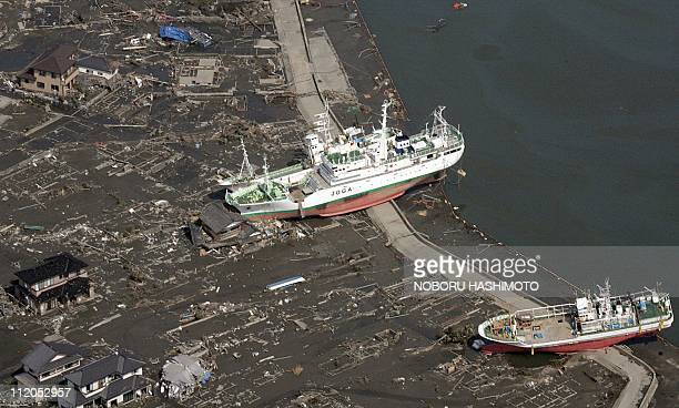 This aerial view taken on March 14 2011 during an AFPchartered flight shows boats washed ashore near Sendai in Miyagi prefecture three days after a...