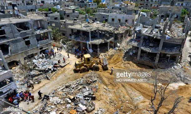This aerial view taken on May 21 shows a neighbourhood in Beit Hanun in the northern Gaza Strip, that was targeted by Israeli air strikes during the...