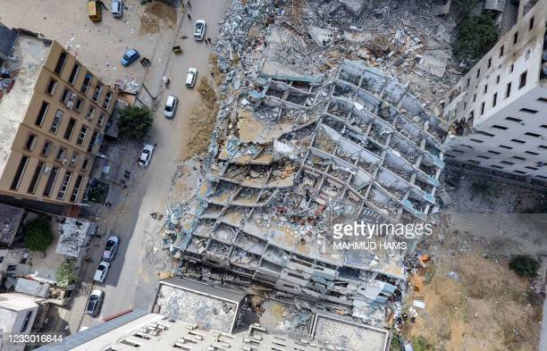This aerial view taken on May 21 shows the Al-Jalaa Tower in Gaza City, that was levelled by an Israeli air strike during the recent military...