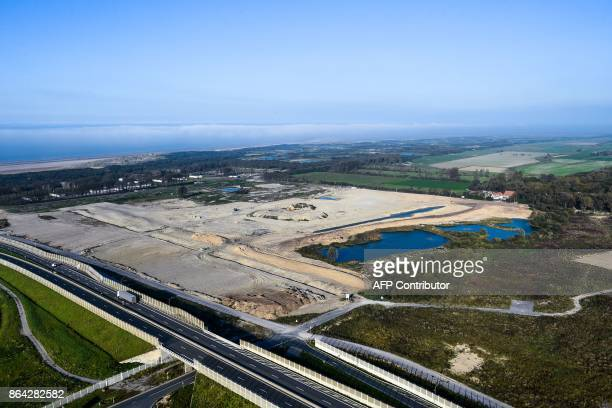 This aerial view taken on October 14 2017 shows the site of the former 'Jungle' migrant camp that was evacuated 12 months ago in Calais A year after...