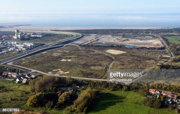 This aerial view taken on October 14 2017 shows the site of the former 'Jungle' migrant camp that was evacuated 12 months ago in Calais and the...