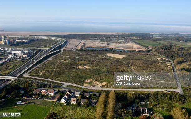 This aerial view taken on October 14 2017 shows the site of the former Jungle migrant camp that was evacuated 12 months ago in Calais and the...