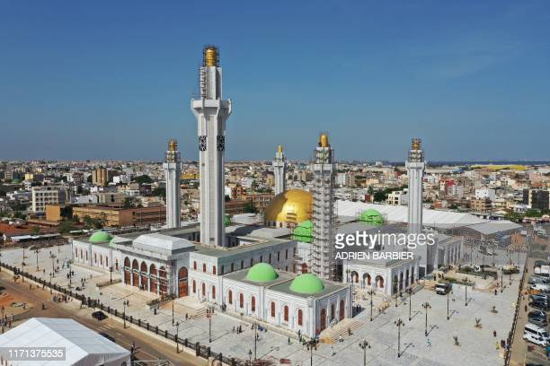 This aerial view taken on on September 23 shows the Great Mosque of the Mourides in Dakar, on the eve of the inauguration of the building in the...
