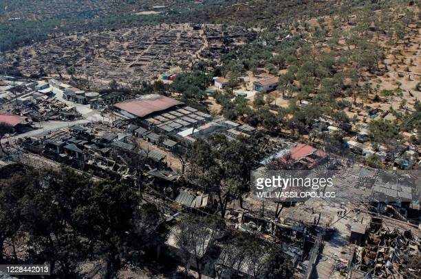 This aerial view taken on September 10, 2020 shows the burnt Moria refugee camp in the island of Lesbos as Greek authorities were racing today to...