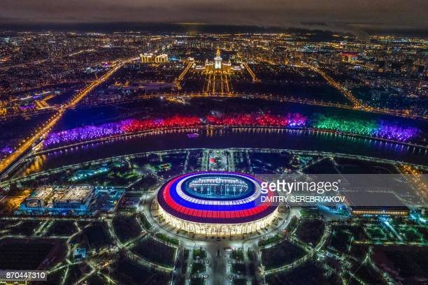 TOPSHOT This aerial view taken with a drone shows Luzhniki Stadium and the Moskva River in Moscow on November 4 2017 Luzhniki Stadium will host seven...