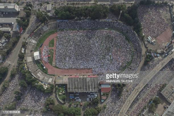 This aeriel view shows Muslim worshippers listening to the Eid al-Fitr morning prayer sermon at a soccer stadium in Addis Ababa, Ethiopia, on May 13,...