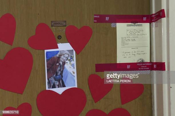 This AFP TV video frame grab shows a picture of Mireille Knoll heartshaped documents and seals of the police posted on the door of her apartment in...