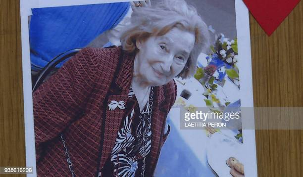 This AFP TV video frame grab shows a picture of Mireille Knoll posted on the door of her apartment in Paris on March 27 2018 after she was found dead...