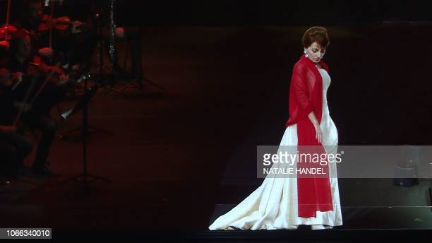 This AFP TV video frame grab shows the hologram of Maria Callas walking on stage during an hologramconcert at the Salle Pleyel in Paris on November...